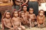 papuan experience-Dani lady on pig fieast, Dani pacific-melanesia race